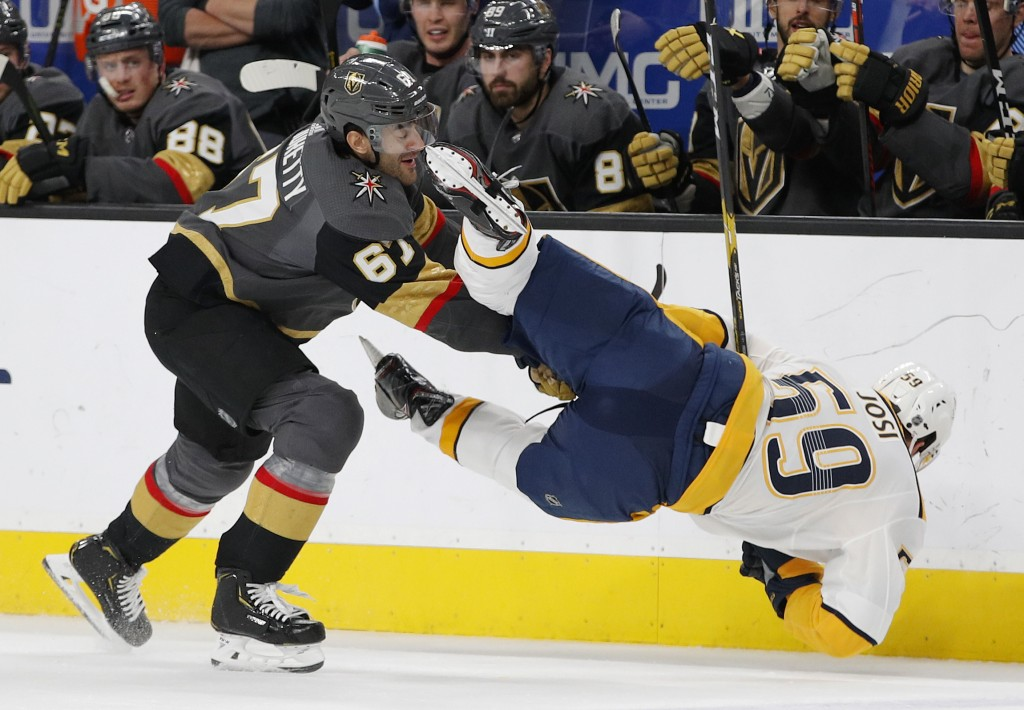 Vegas Golden Knights left wing Max Pacioretty (67) checks Nashville Predators defenseman Roman Josi during the second period of an NHL hockey game Sat...