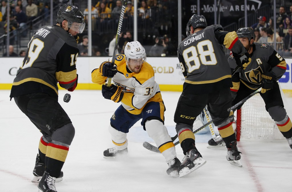 Vegas Golden Knights right wing Reilly Smith, Nashville Predators right wing Viktor Arvidsson, and Golden Knights defensemen Nate Schmidt and Deryk En...