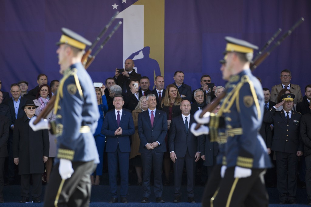 Kosovo president Hashim Thaci, center, watches the Kosovo Security Force members parade, during celebrations to mark the 11th anniversary of independe...