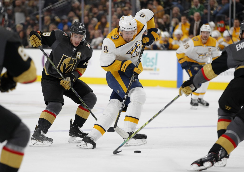 Nashville Predators left wing Filip Forsberg (9) skates around Vegas Golden Knights right wing Reilly Smith (19) during the first period of an NHL hoc...