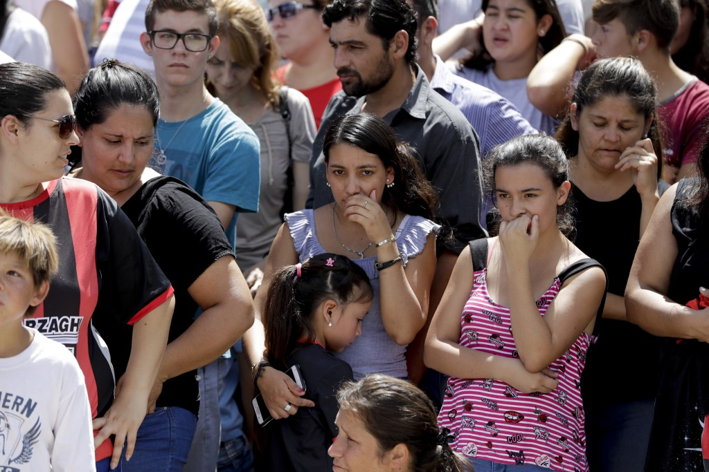 Neighbors of Argentine soccer player Emiliano Sala, wait for his remains to depart for Santa Fe after his wake in Progreso, Argentina, Saturday, Feb. ...