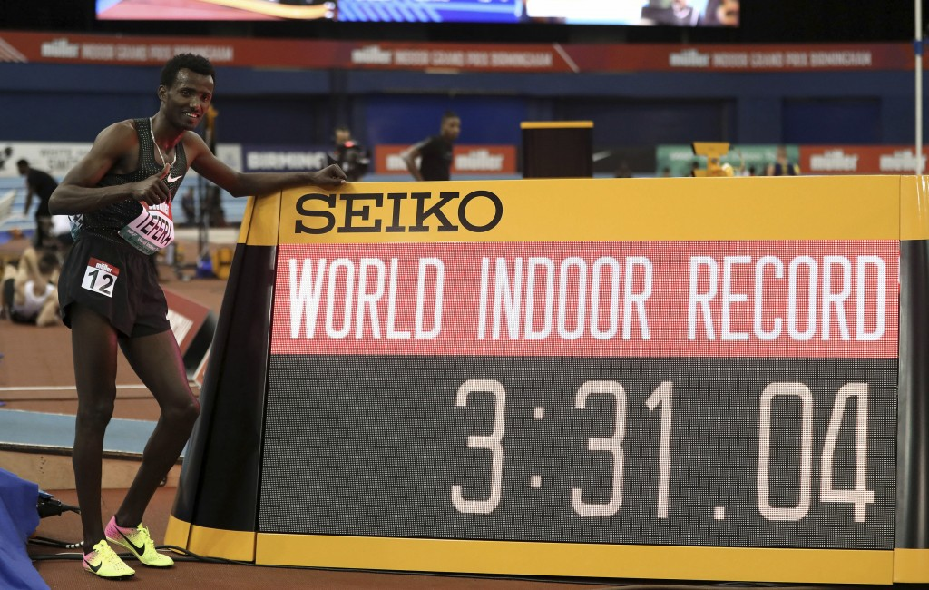 Ethiopia's Samuel Tefera poses next to teh time indicator, as he celebrates getting the mens 1500 metre World Indoor Record during the Muller Indoor G...