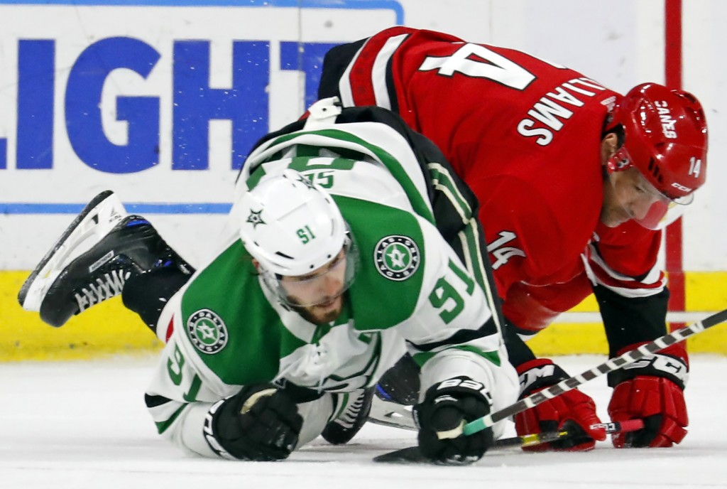 Carolina Hurricanes' Justin Williams (14) collides with Dallas Stars' Tyler Seguin (91) during the second period of an NHL hockey game, Saturday, Feb....