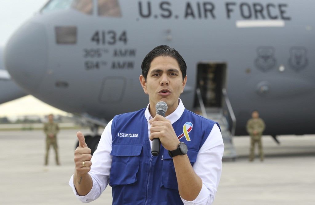 Lester Toledo from the Coalition Aid and Freedom Venezuela speaks in front of a C-17 cargo plane loaded with humanitarian commodities at Homestead Air...