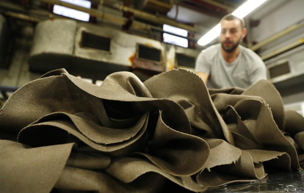 A pile of hats is seen in Borsalino's hat factory, in Spinetta Marengo, near Alessandria, Italy, Thursday, Jan. 17, 2019. Borsalino's prized felt hats...