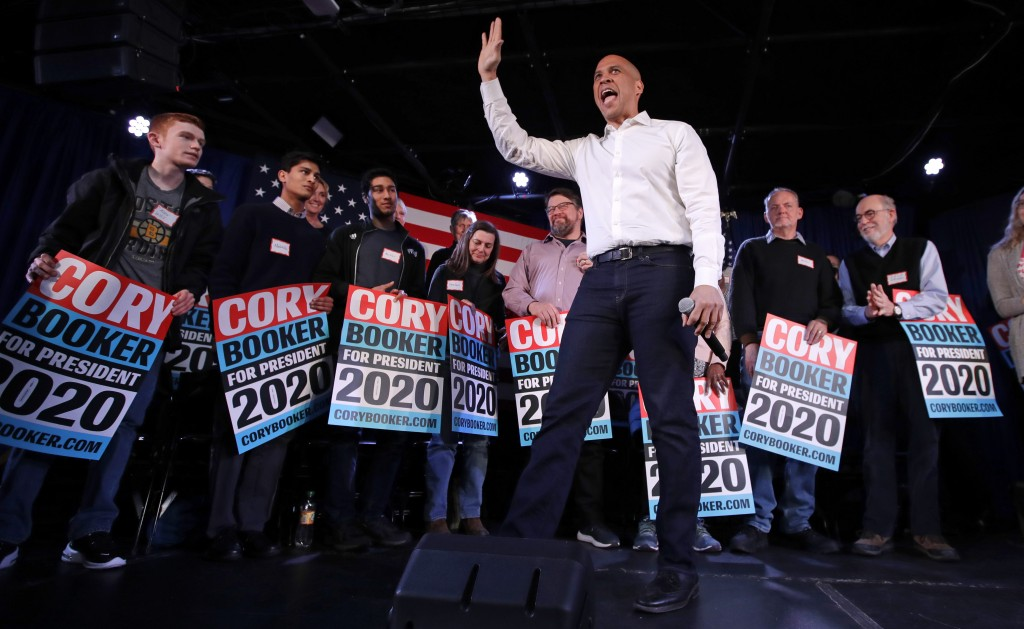 U.S. Sen. Cory Booker, D-N.J., waves to the crowd during a campaign stop in Portsmouth, N.H., Saturday, Feb. 16, 2019. (AP Photo/Charles Krupa)