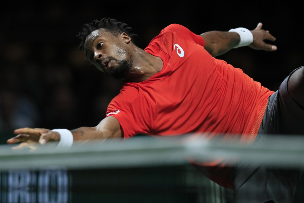 Gael Monfils of France drops his racket when returning a ball against Daniil Medvedev of Russia in the semi-finals of the ABN AMRO world tennis tourna...