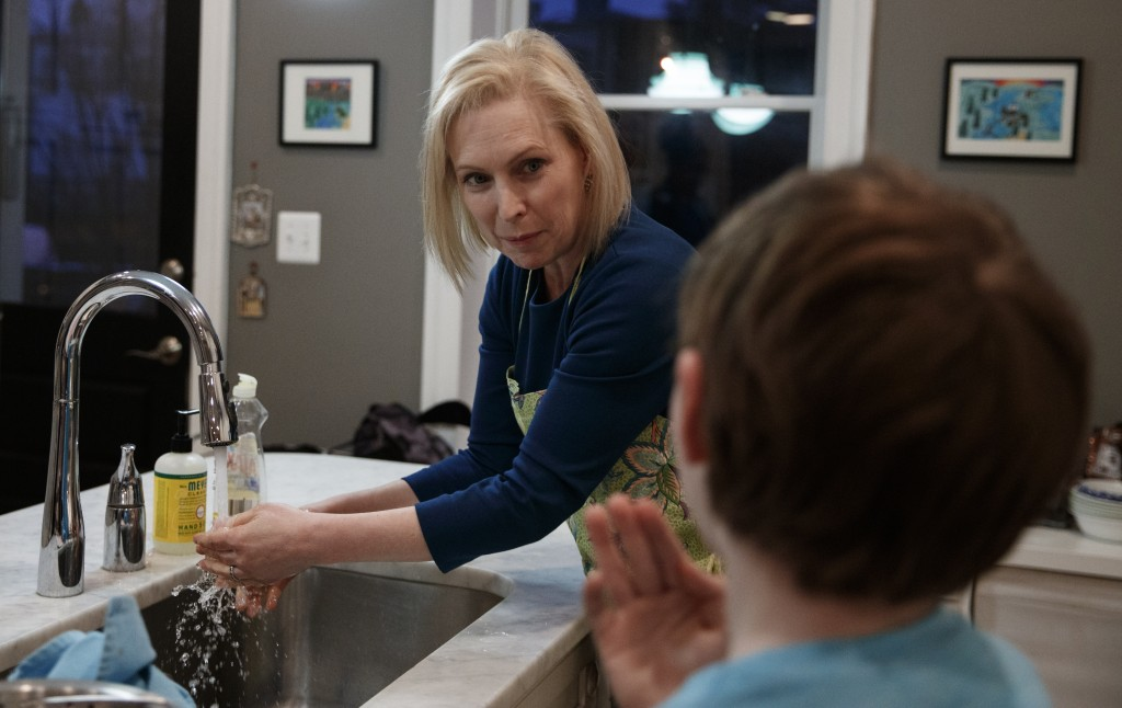 Sen. Kirsten Gillibrand, D-N.Y., talks with her son Henry Gillibrand as she prepares dinner at her home in Washington, Tuesday, Feb. 12, 2019. Gillibr...