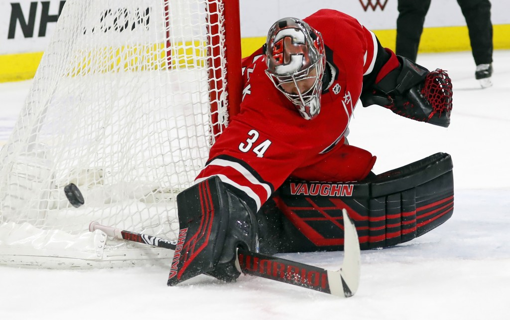 Carolina Hurricanes goaltender Petr Mrazek (34) blocks a shot of the Dallas Stars during the second period of an NHL hockey game, Saturday, Feb. 16, 2...