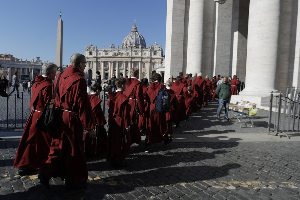 Faithful arrive in St. Peter's Square to attend Pope Francis' Angelus noon prayer at the Vatican, Sunday, Feb. 17, 2019. (AP Photo/Gregorio Borgia)