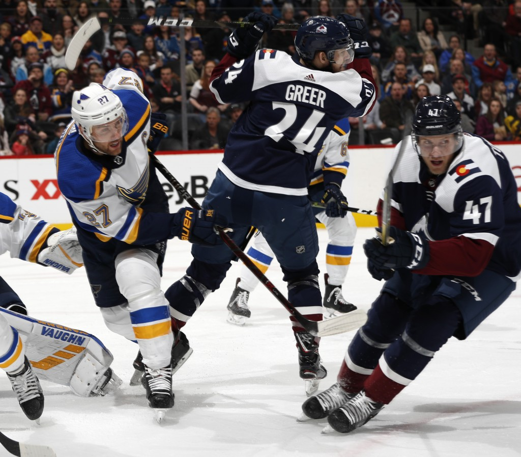 St. Louis Blues defenseman Alex Pietrangelo, left, clears the puck form in front of the crease and past Colorado Avalanche left wing A.J. Greer and ce...
