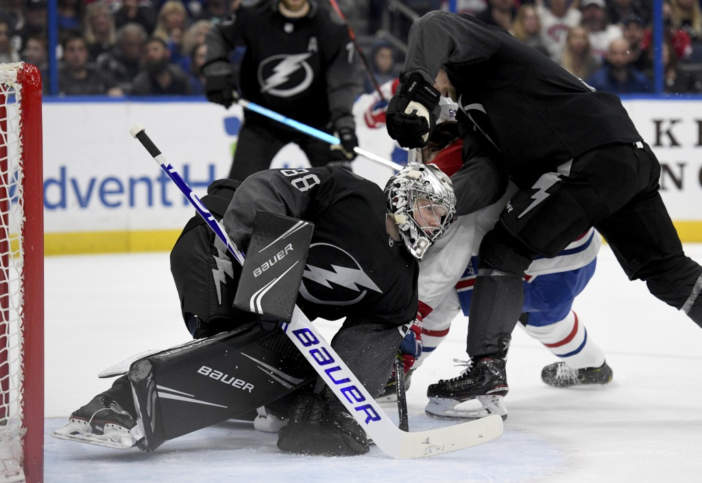Tampa Bay Lightning goaltender Andrei Vasilevskiy (88) covers the puck during the first period of an NHL hockey game against the Montreal Canadiens, S...