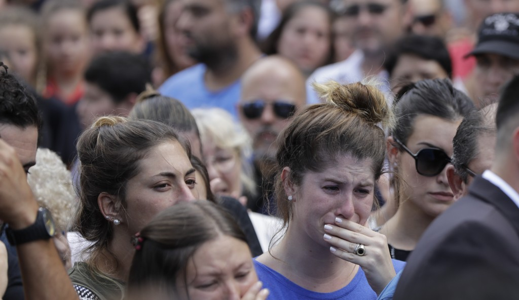 Relatives and friends of Argentine soccer player Emiliano Sala cry after his wake in Progreso, Argentina, Saturday, Feb. 16, 2019. The Argentina-born ...