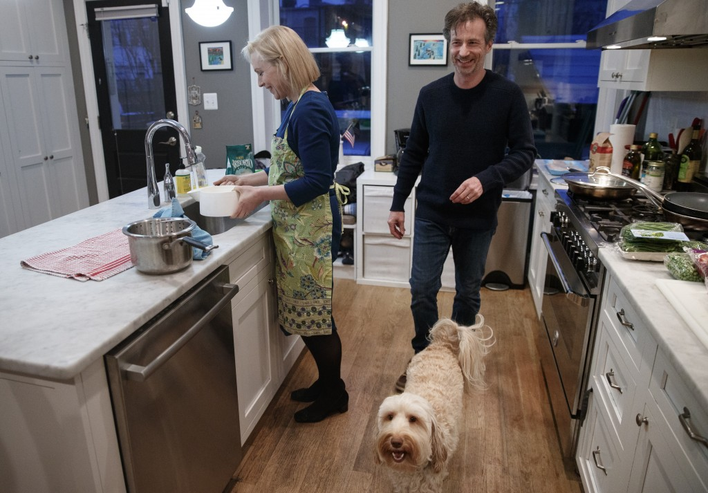 Sen. Kirsten Gillibrand, D-N.Y., prepares rice for dinner in her kitchen at home in Washington, Tuesday, Feb. 12, 2019, with her husband Jonathan Gill...