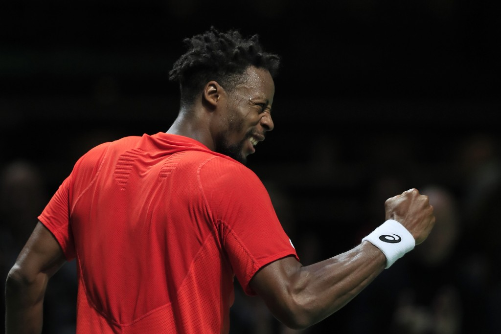Gael Monfils of France celebrates defeating Daniil Medvedev of Russia in three sets, 4-6, 6-3, 6-4, in the semi-finals of the ABN AMRO world tennis to...