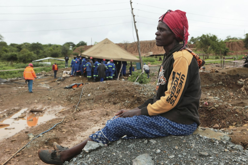 Mary Zindege waits for news of her son after dozens of small-scale gold miners were caught underground Tuesday on the outskirts of Kadoma town about 2...