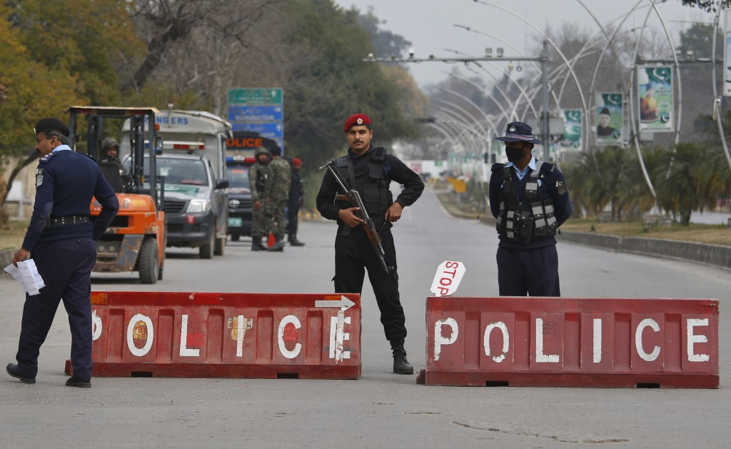 Pakistani police commandos and paramilitary soldiers stand guard at a highway to ensure security ahead of Saudi Arabia's crown prince visit to Pakista...