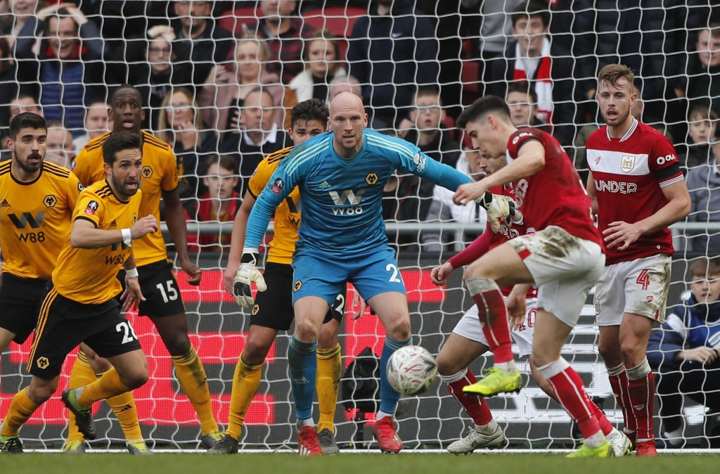 Wolverhampton goalkeeper John Ruddy, center, eyes the ball during the English FA Cup fifth round soccer match between Bristol City and Wolverhampton W...