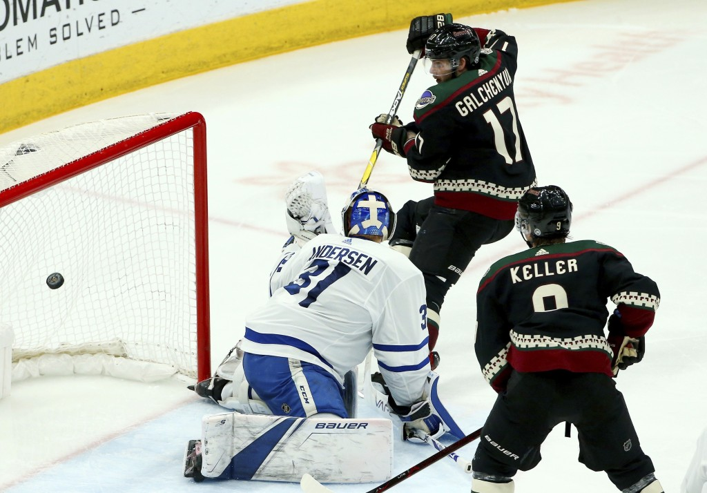 Arizona Coyotes center Alex Galchenyuk (17) sends the puck past Toronto Maple Leafs goaltender Frederik Andersen (31) for a goal as Coyotes center Cla...