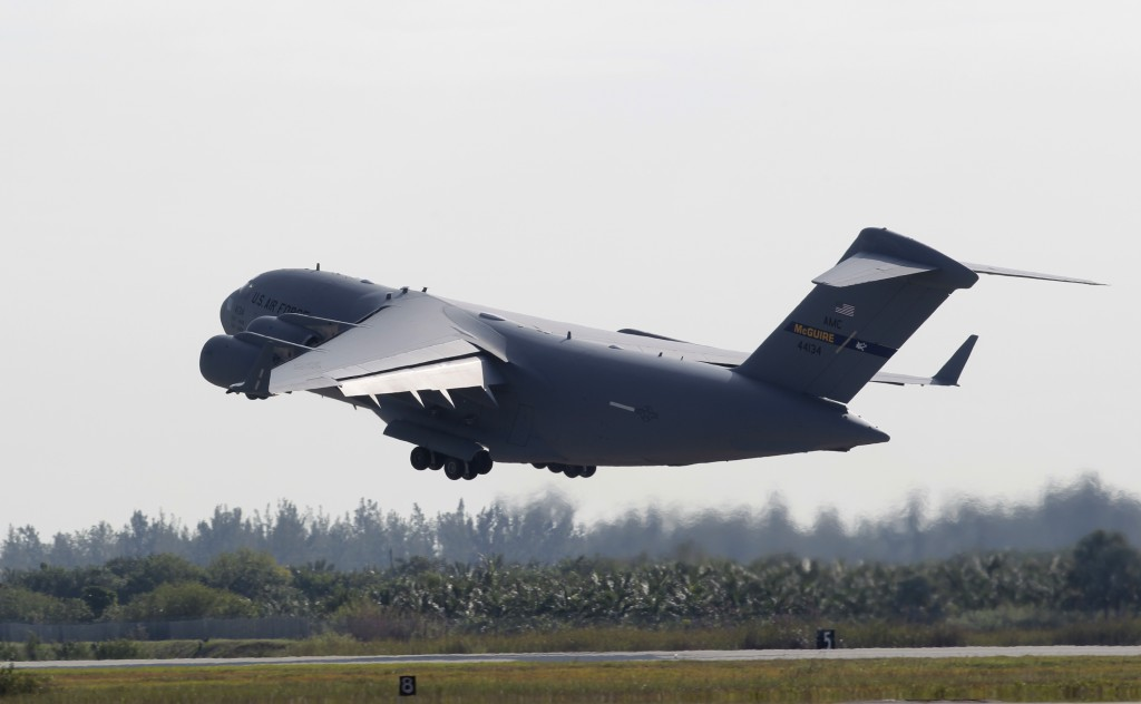 A C-17 cargo plane loaded with humanitarian commodities takes off from Homestead Air Reserve Base in route to Venezuela, Saturday, Feb. 16, 2019, in H...