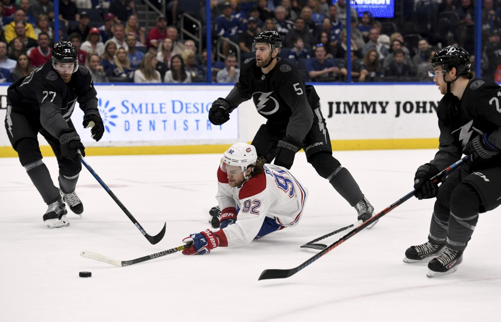 Montreal Canadiens left wing Jonathan Drouin (92) shoots after being tripped by Tampa Bay Lightning defenseman Dan Girardi (5) during the first period...