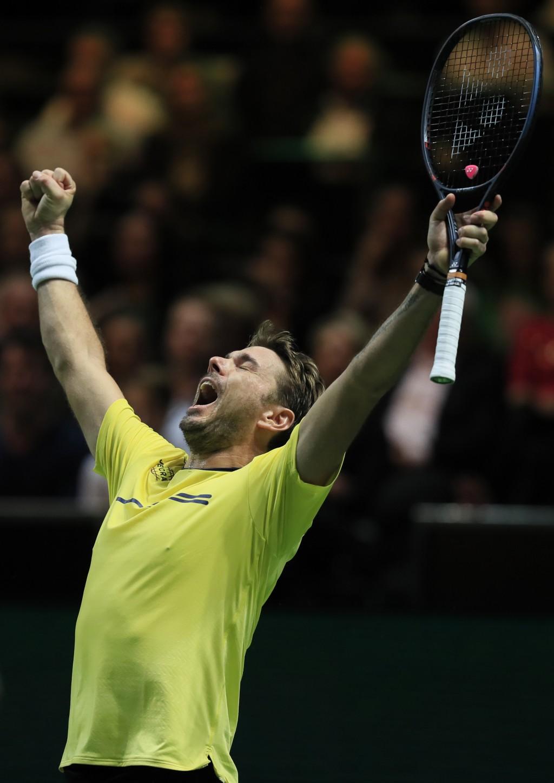 Stan Wawrinka of Switzerland celebrates winning against Kei Nishikori of Japan in three sets 6-2, 4-6, 6-4, in the semi-finals of the ABN AMRO world t...