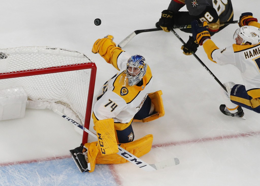 Nashville Predators goaltender Juuse Saros (74) watches the puck fly through the air during the first period of an NHL hockey game against the Vegas G...