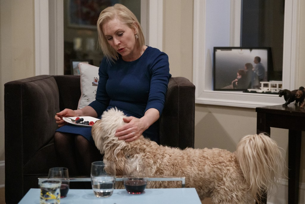 Sen. Kirsten Gillibrand, D-N.Y., pets her 2 year-old labradoodle Maple in her home in Washington, Tuesday, Feb. 12, 2019. Gillibrand isn't just embrac...