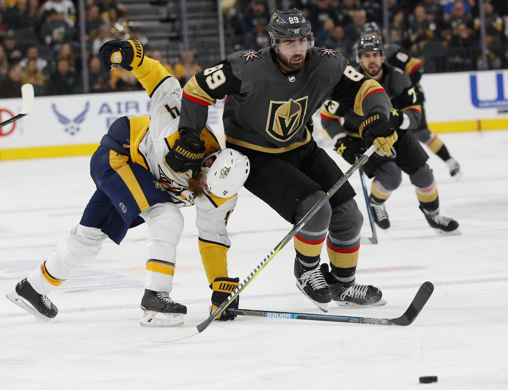 Vegas Golden Knights right wing Alex Tuch (89) skates around Nashville Predators defenseman Ryan Ellis (4) during the second period of an NHL hockey g...