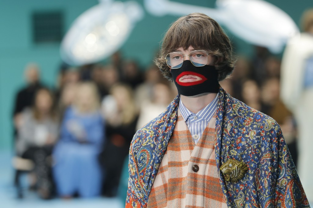 FILE - In this Feb. 21, 2018, file photo, a model wears a creation as part of the Gucci women's Fall/Winter 2018-2019 collection, presented during the...