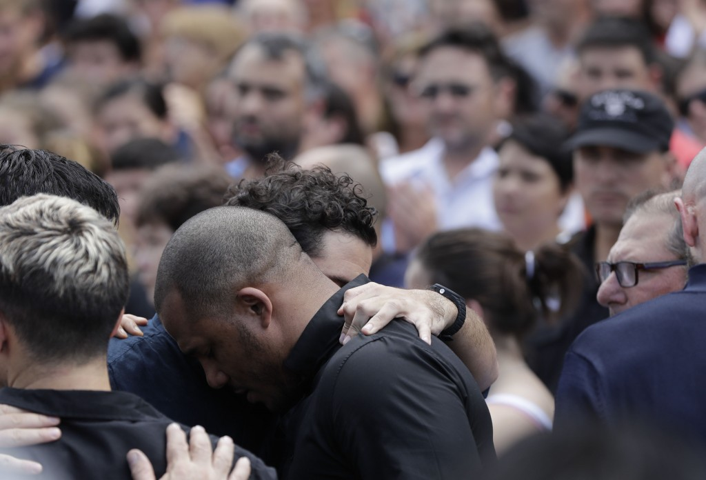 Relatives and friends of Argentine soccer player Emiliano Sala mourn after his wake in Progreso, Argentina, Saturday, Feb. 16, 2019. The Argentina-bor...