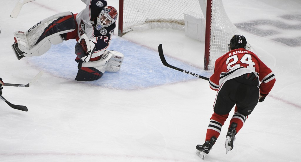 Columbus Blue Jackets goaltender Sergei Bobrovsky (72) defends against Chicago Blackhawks center Dominik Kahun (24) during the second period of an NHL...