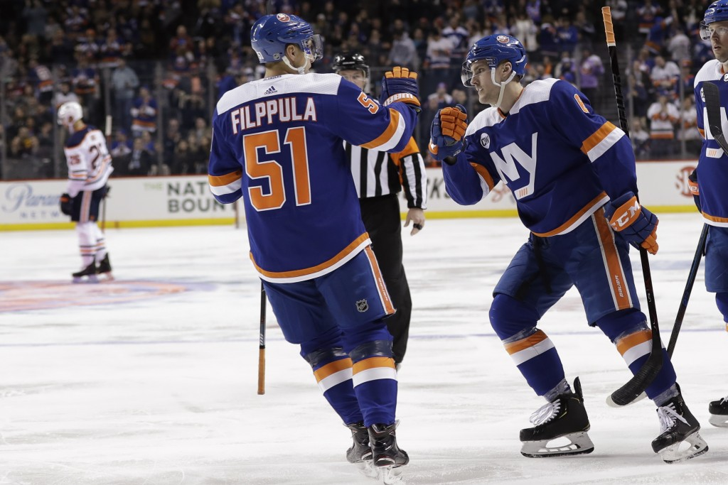 New York Islanders' Ryan Pulock, right, celebrates with teammate Valtteri Filppula after scoring a goal during the second period of the team's NHL hoc...