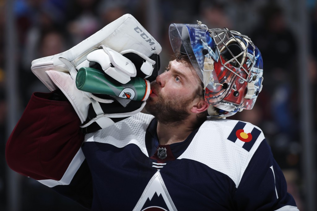 Colorado Avalanche goaltender Semyon Varlamov takes a drink during a time out against the St. Louis Blues in the second period of an NHL hockey game S...