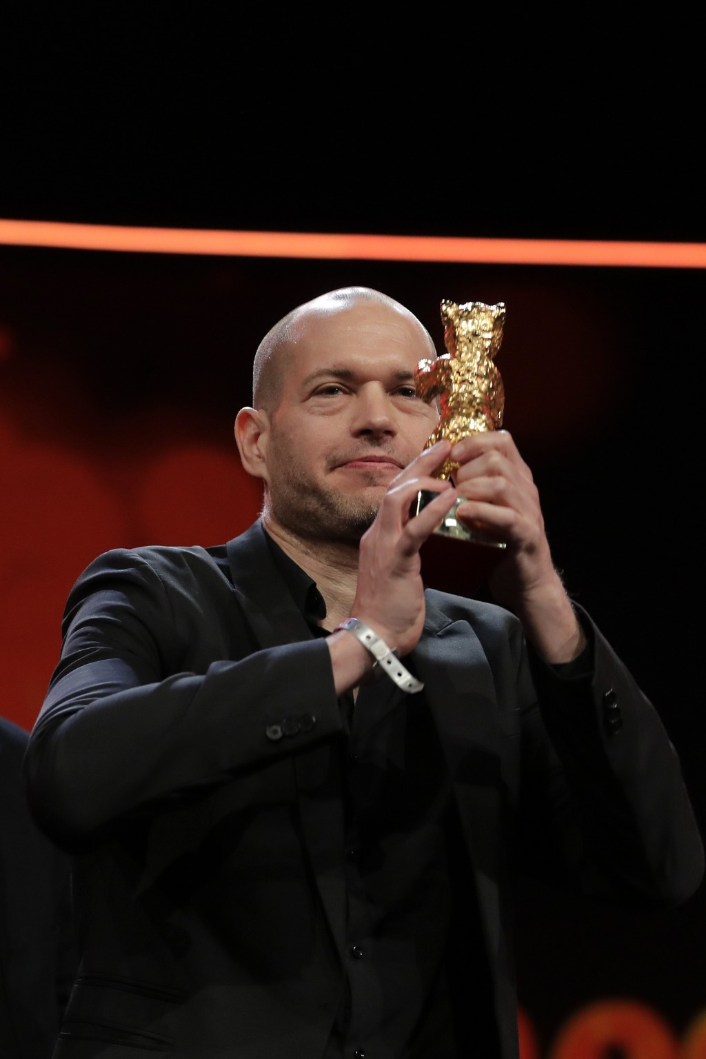 Director Nadav Lapid holds aloft the golden bear for best film for 'Synonyms' onstage at the award ceremony of the 2019 Berlinale Film Festival in Ber...