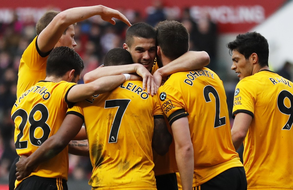 Wolverhampton players celebrate after Ivan Cavaleiro, center left, scored the opening goal during the English FA Cup fifth round soccer match between ...