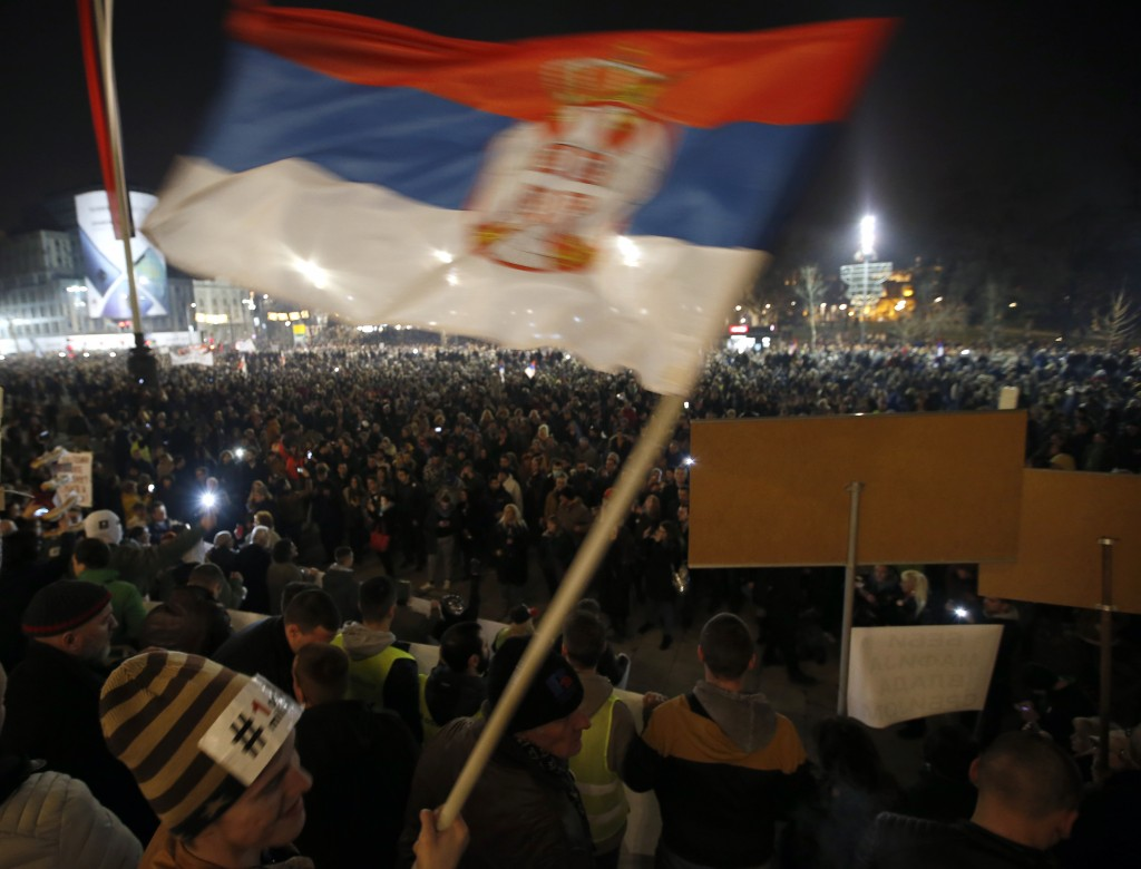 People gather in front of the Serbian parliament building during a protest march against populist President Aleksandar Vucic in Belgrade, Serbia, Satu...