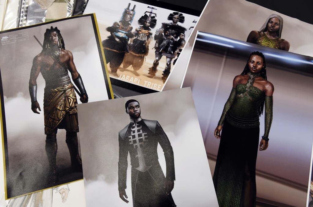 """This Jan. 15, 2019 photo shows renderings of fashions created by Oscar nominated costume designer Ruth E. Carter for the film """"Black Panther,"""" in Los ..."""