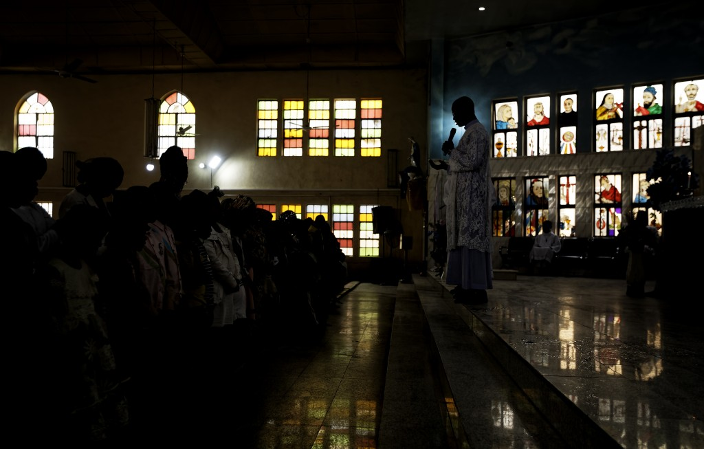 Churchgoers prepare to take communion at a morning service at the Saint Charles Catholic Church, the site of a 2014 bomb attack blamed on Islamic extr...