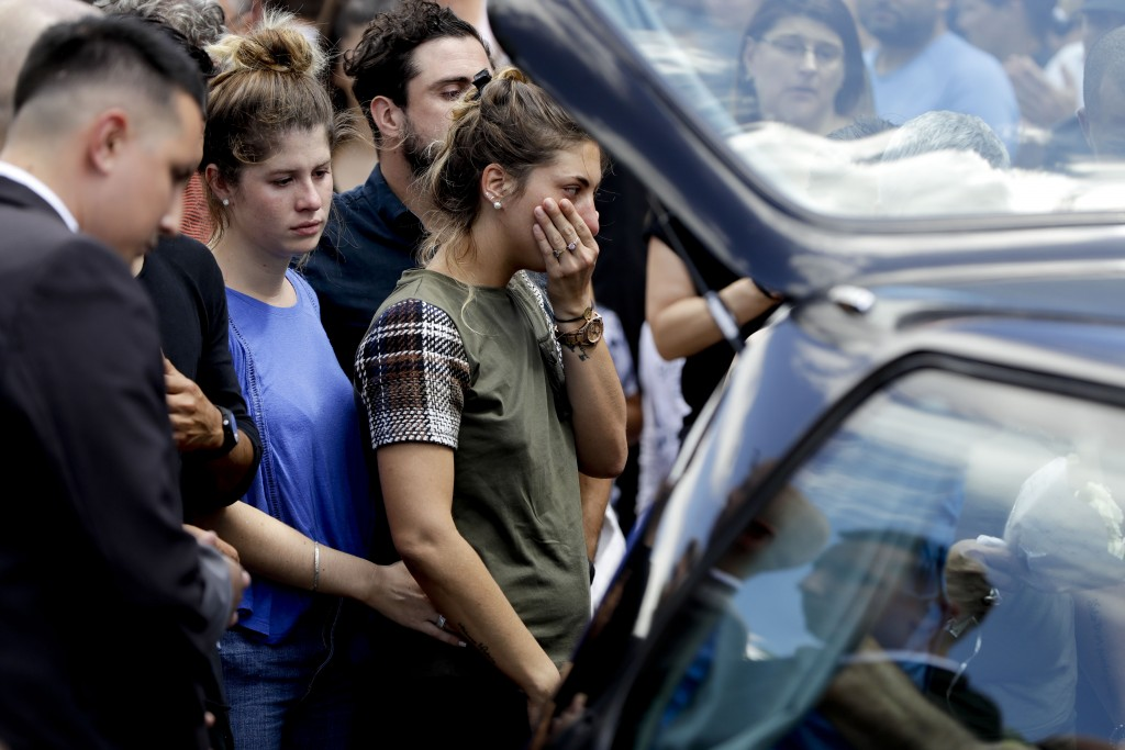 Romina Sala, the sister Argentine soccer player Emiliano Sala, cries at the end of her brother's wake in Progreso, Argentina, Saturday, Feb. 16, 2019....