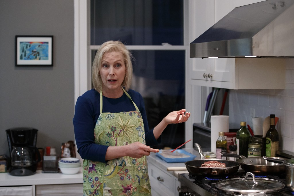 Sen. Kirsten Gillibrand, D-N.Y., talks as she prepares dinner in her kitchen at home in Washington, Tuesday, Feb. 12, 2019. Gillibrand isn't just embr...