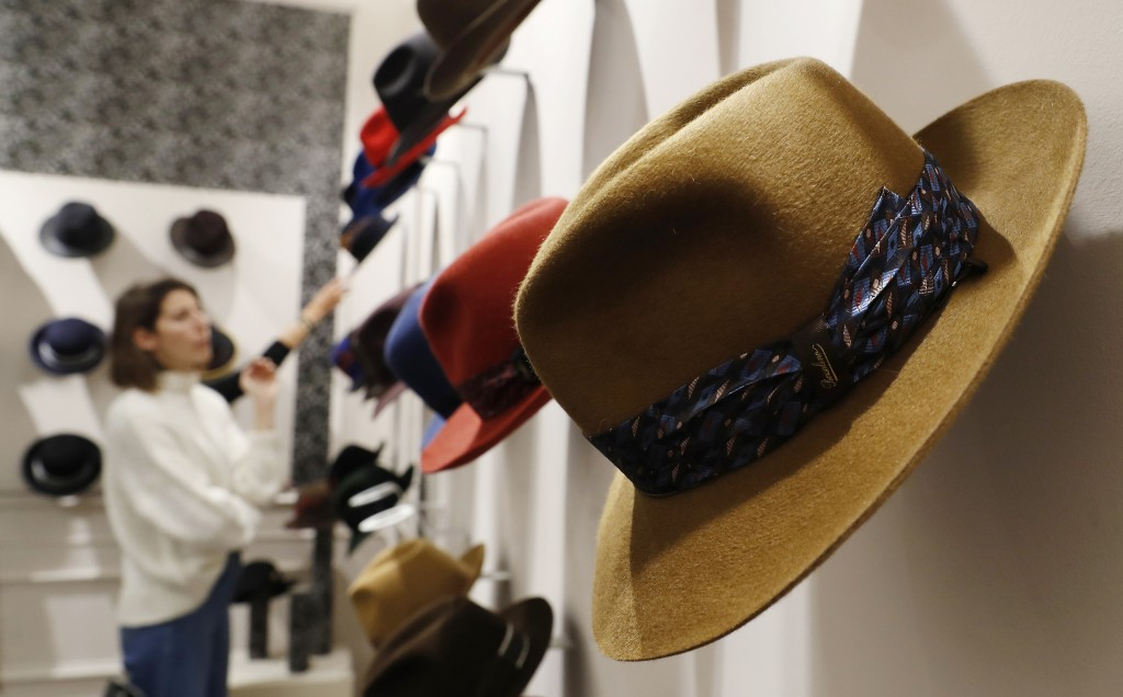 A woman looks at hats in a Borsalino store in downtown Milan, Italy, Wednesday, Jan. 16, 2019. If the traditional Italian hat-maker Borsalino was once...