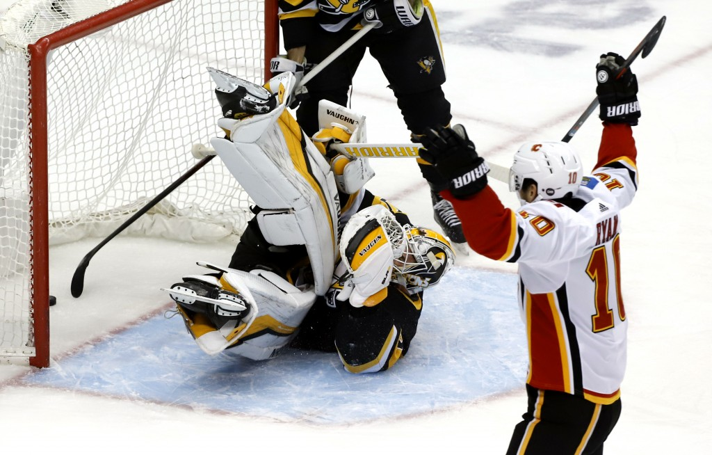 Calgary Flames' Derek Ryan (10) celebrates after teammate Andrew Mangiapane put a shot behind Pittsburgh Penguins goaltender Matt Murray (30) for a go...
