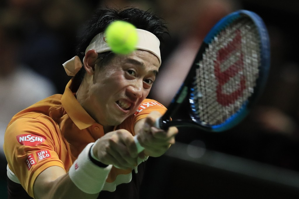 Kei Nishikori of Japan plays a shot against Stan Wawrinka of Switzerland in the semi-finals of the ABN AMRO world tennis tournament at Ahoy Arena in R...