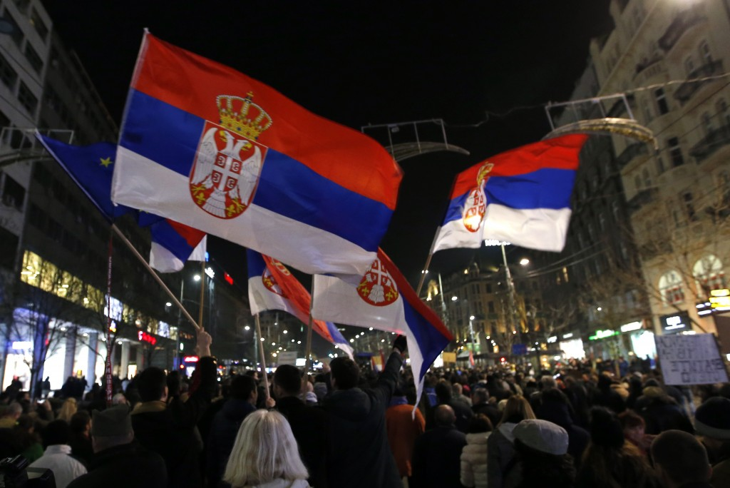 People march during a protest march against populist President Aleksandar Vucic in Belgrade, Serbia, Saturday, Feb. 16, 2019. People protested against...