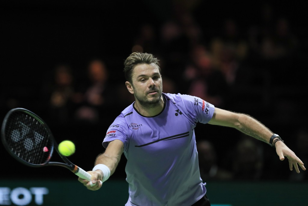 Stan Wawrinka of Switzerland plays a shot against Gael Monfils of France in the men's singles final of the ABN AMRO world tennis tournament at Ahoy Ar...