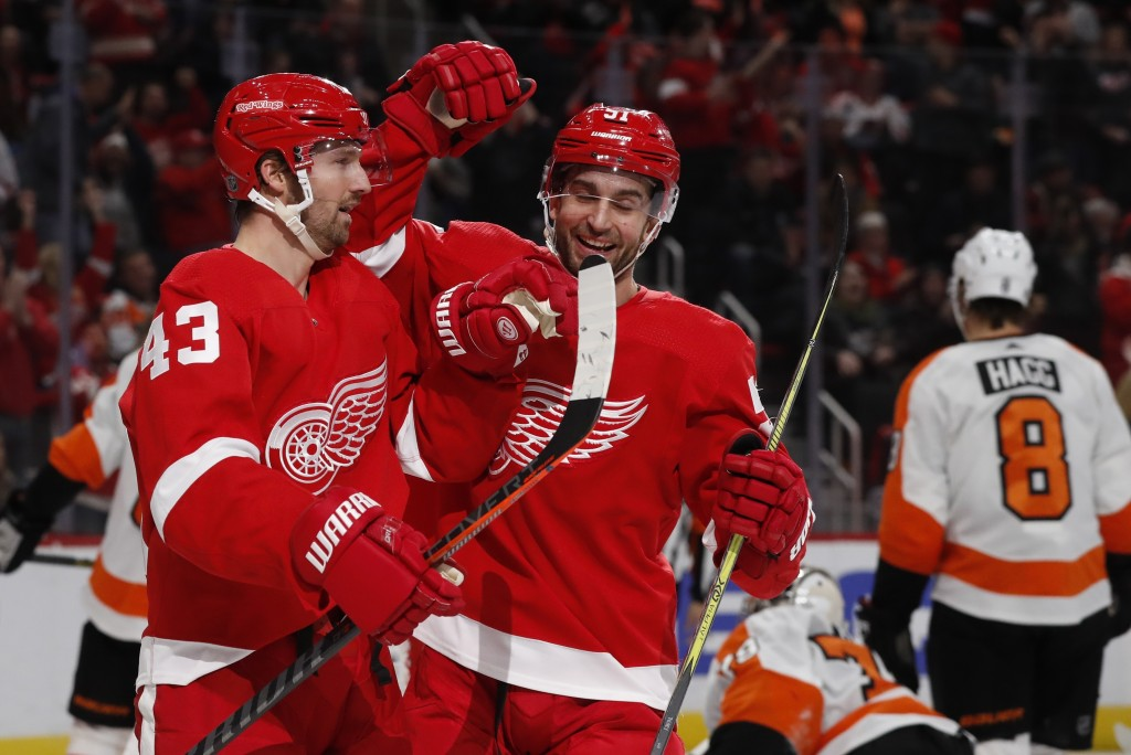 Detroit Red Wings left wing Darren Helm (43) is congratulated on his goal by teammate center Frans Nielsen (51) during the second period of an NHL hoc