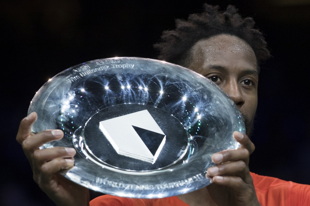 Gael Monfils of France holds the trophy as he celebrates winning against Stan Wawrinka of Switzerland in three sets, 6-3, 1-6, 6-2, in the men's singl...