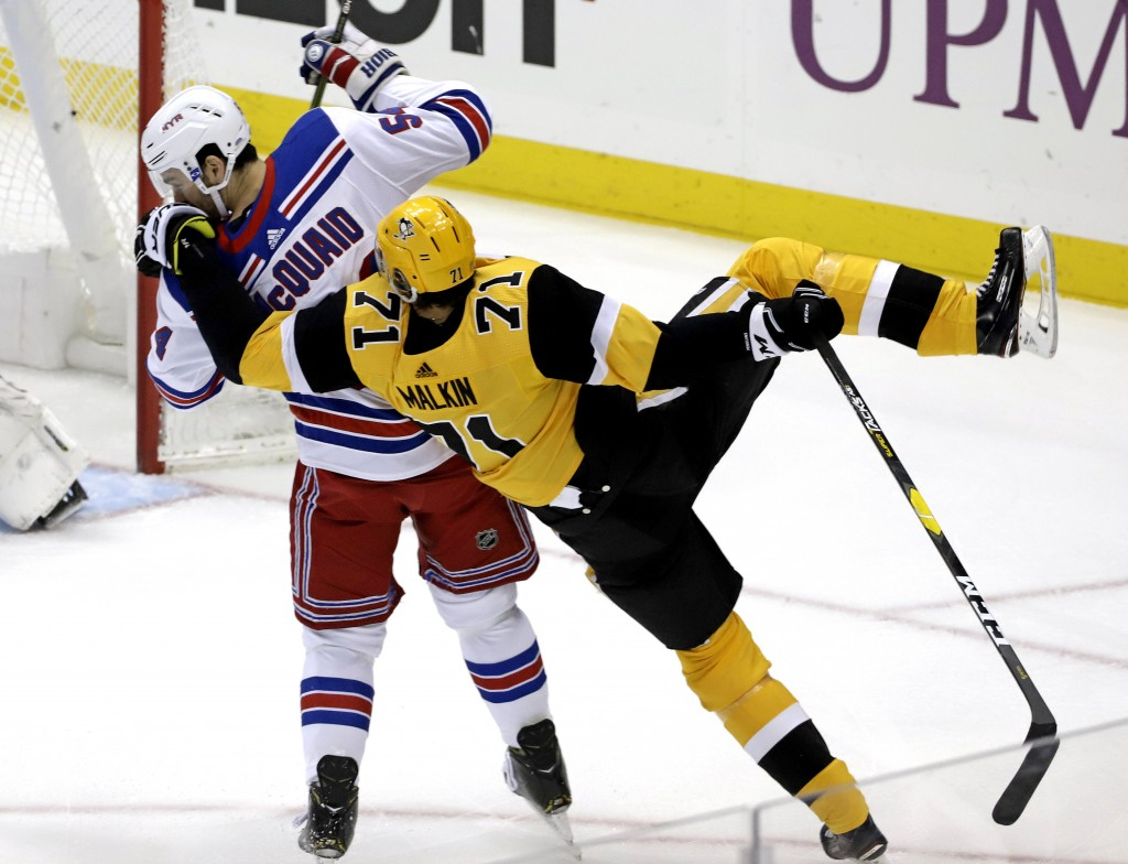 Pittsburgh Penguins' Evgeni Malkin (71) is upended by New York Rangers' Adam McQuaid (54) during the first period of an NHL hockey game in Pittsburgh,...