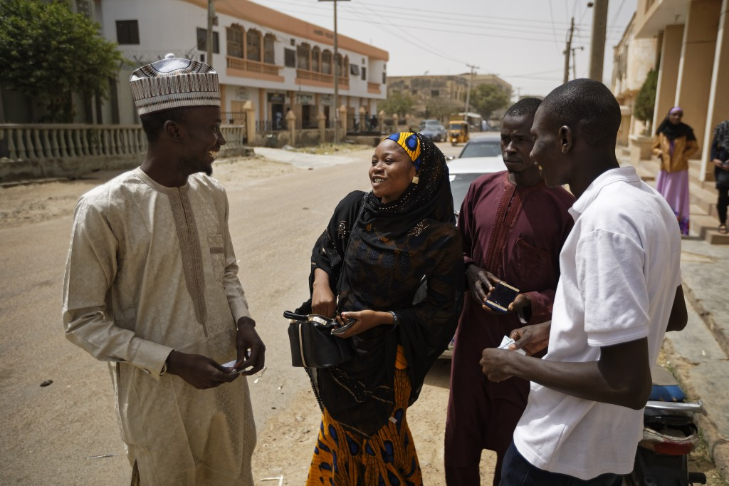 In this photo taken Friday, Feb. 15, 2019, Zainab Sulaiman Umar, 26, center, a candidate for the State House of Assembly in Kumbotso constituency, Kan